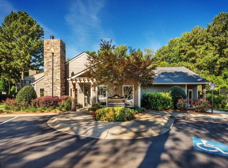 Lush landscaping surrounds you as you drive into Rosemont Apartments, Roswell, GA 30076