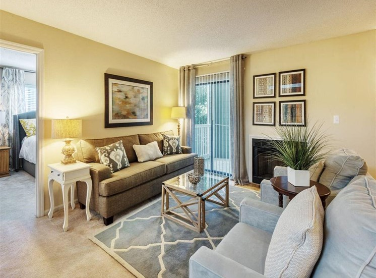 Bright Open Den Living Space with Cozy Fireplaces and Amble Room for Couches and Furniture at Rosemont Apartments, Roswell, GA 30076