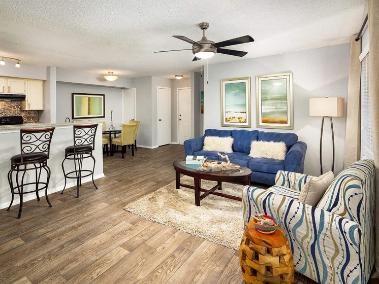 Upgraded interiors featuring wood laminate flooring and ceiling fans at 670 thornton, Lithia Springs, GA
