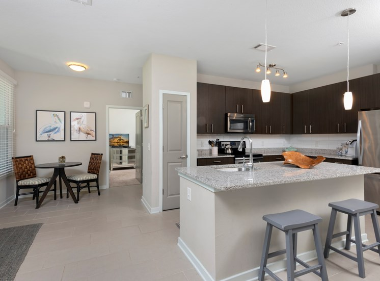 Open Kitchen with Granite and GE appliances at Spyglass Seaside