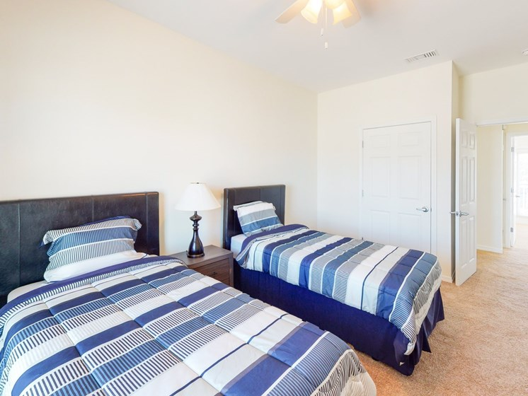 Apartment bedroom with two beds-Marrero Commons, New Orleans, LA