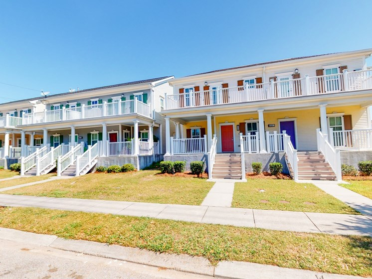 Exterior of apartment buildings with walkway areas from street view-Marrero Commons, New Orleans, LA