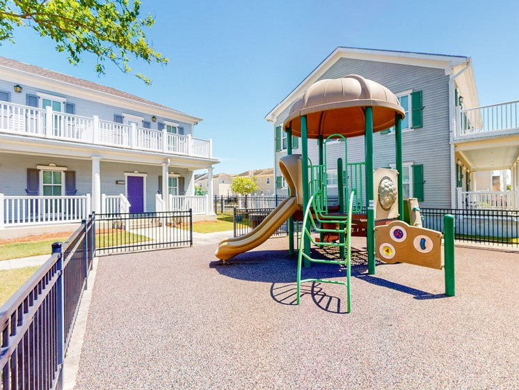 Outdoor playground area with apartment building behind-Marrero Commons, New Orleans, LA