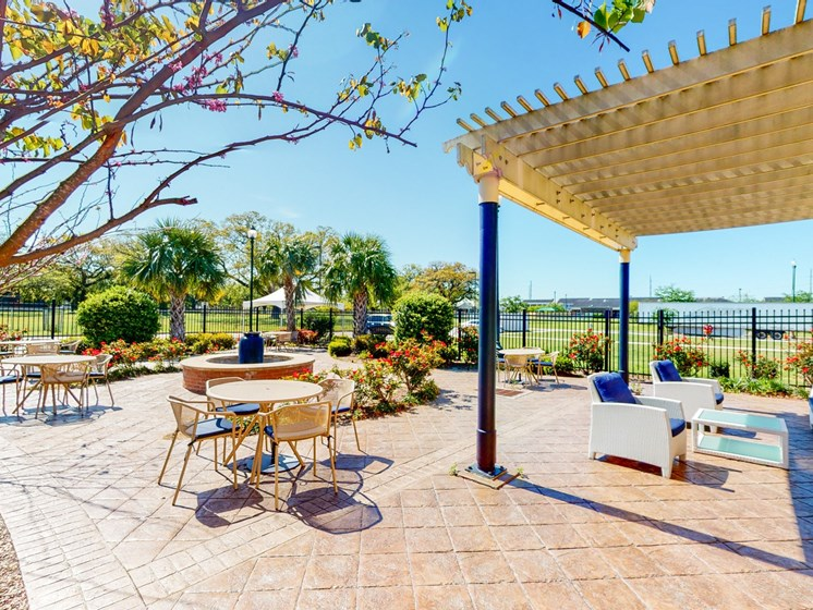 Outdoor lounger area with trellis and seating areas