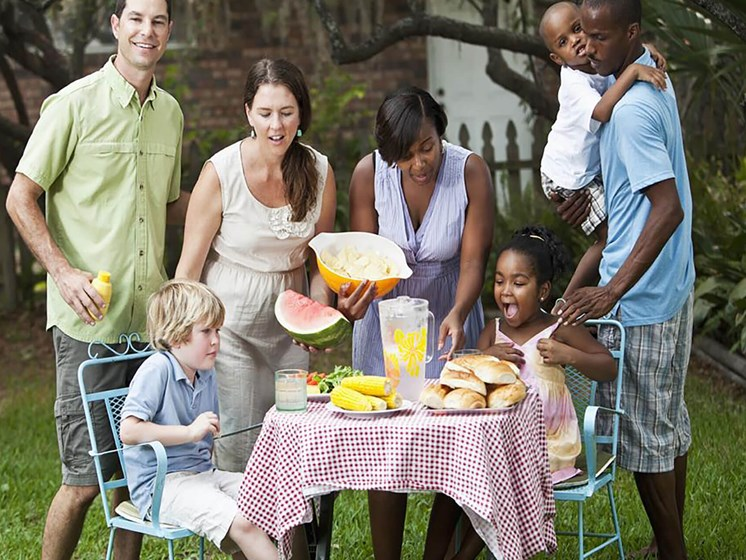 diverse group of friends having an outdoor picnic_Northpark at Scott Carver Apartments Miami, FL