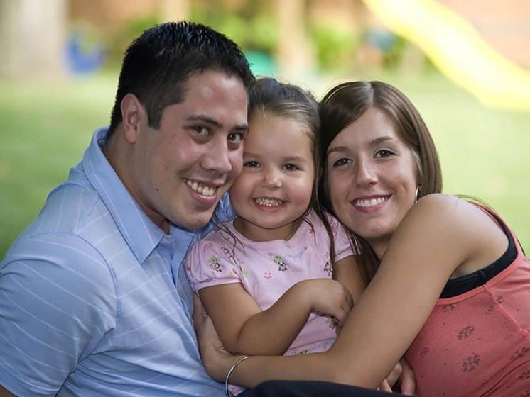 happy parents hugging daughter_Northpark at Scott Carver Apartments Miami, FL
