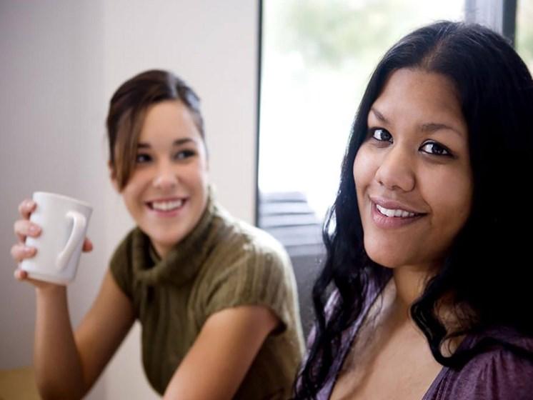 women having coffee_Northpark at Scott Carver Apartments Miami, FL