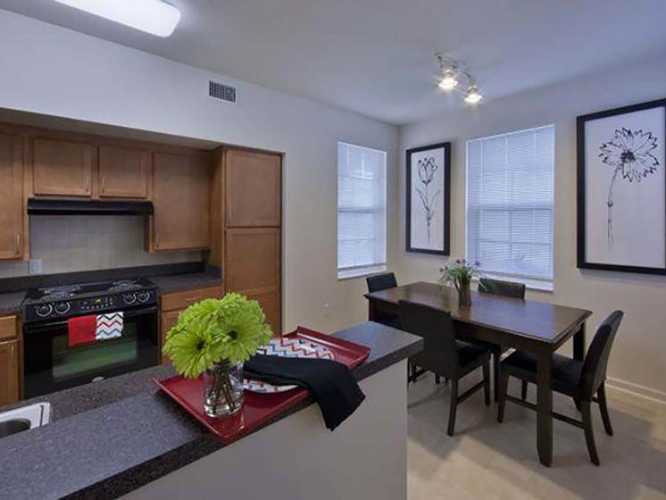 apartment kitchen and dining area_Northpark at Scott Carver Apartments Miami, FL