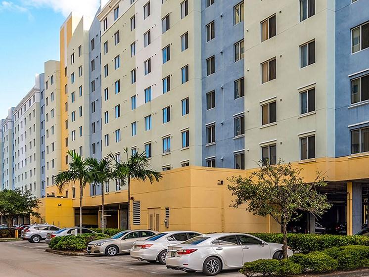 Apartment building exterior and parking lot-Santa Clara I Apartments, Miami, FL