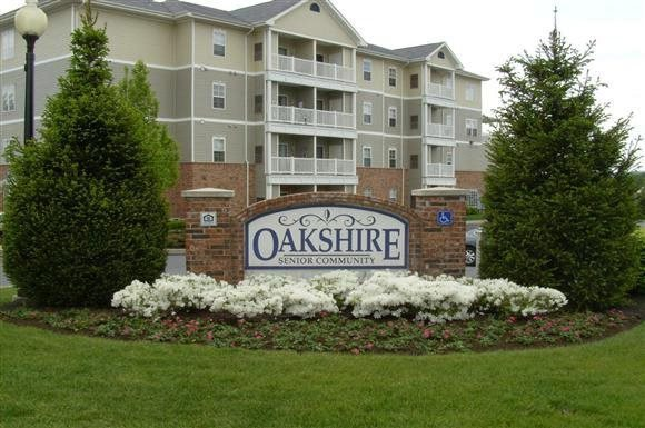 Apartment building with property sign-Oakshire Senior Apartments, Reading, PA 19601