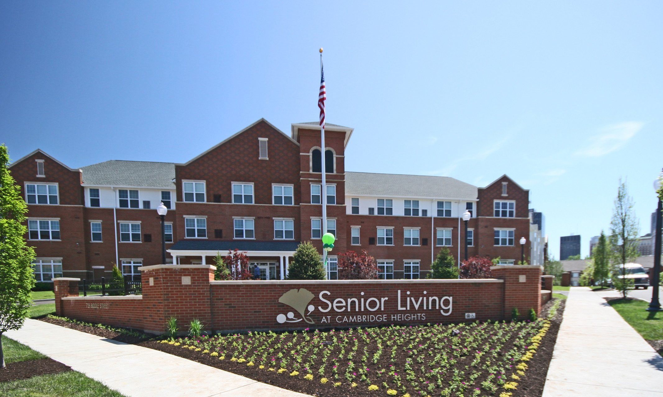 exterior of front apartment building and property sign-Senior Living at Cambridge Heights Apartments, St. Louis, MO