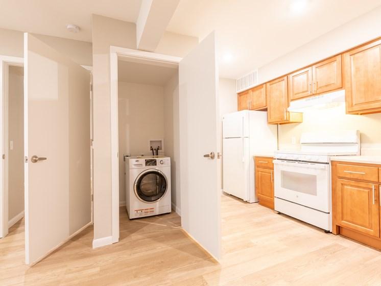 Living and laundry area-Paddock at Park Row, Arlington, TX