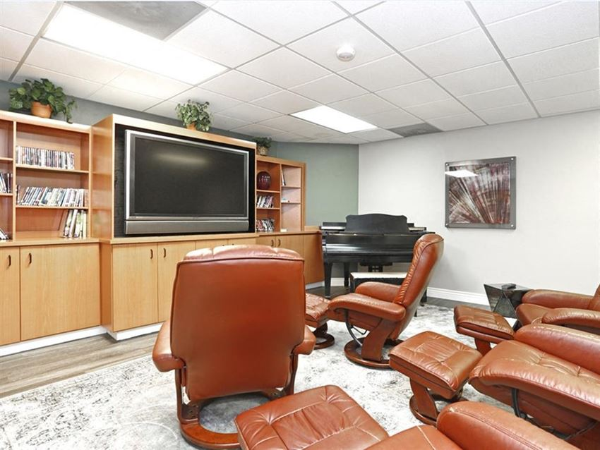 Lounge with recliners, tv, and piano.
