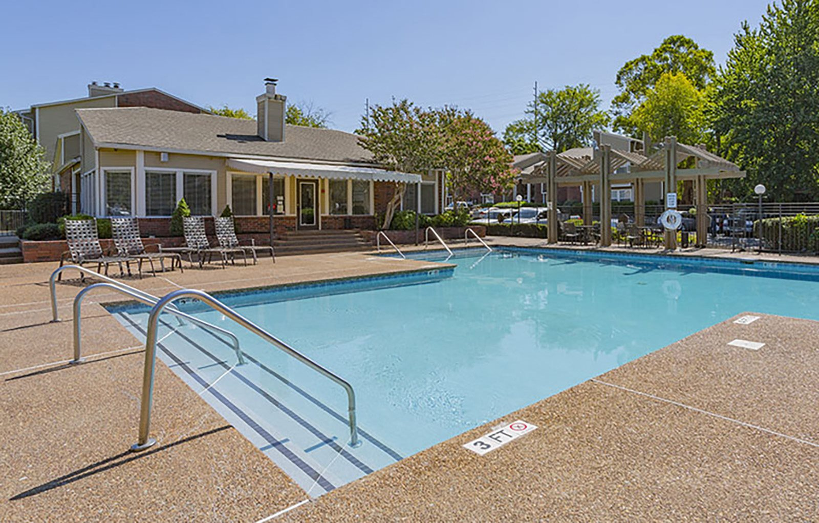 Outdoor pool and sundeck with chairs