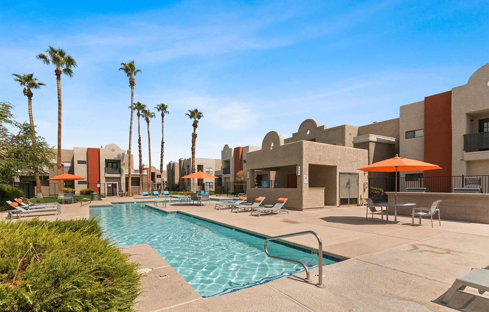 Outdoor pool with apartments in the background