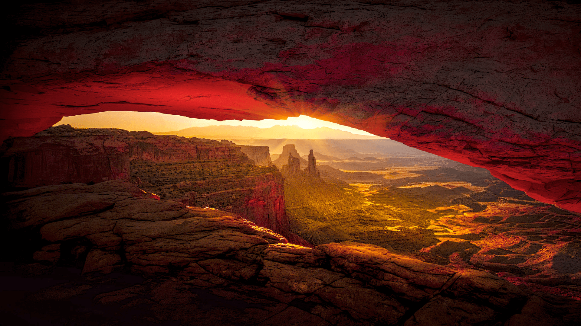 desert sunset with red rock arch