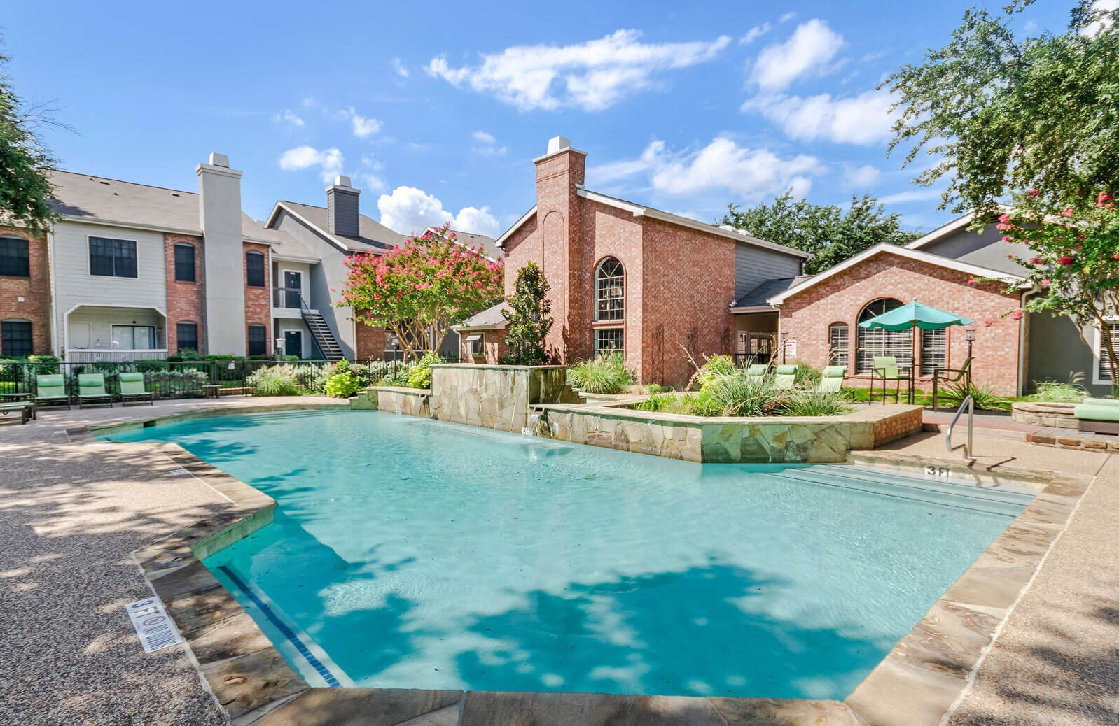 The Ashlar apartment homes courtyard pool and clubhouse
