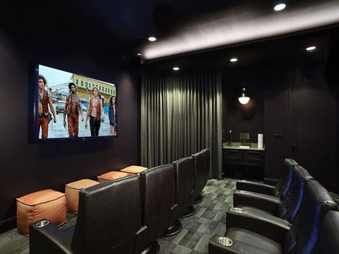 Movie theater room with lounge chairs