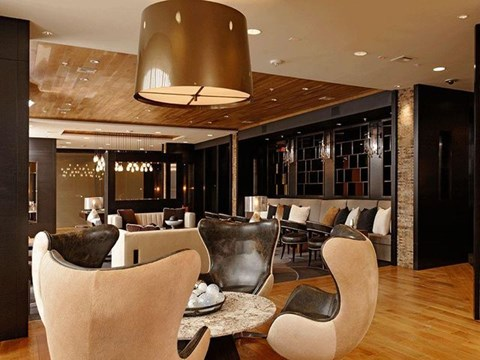 Modern table and chairs with a large lighting fixture
