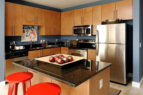 Kitchen with stainless steel appliances and a breakfast bar