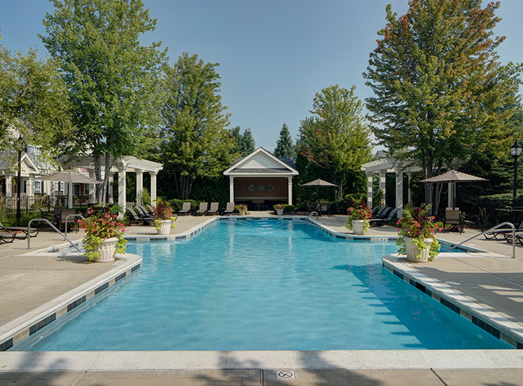 Large Outdoor Pool with Ample Lounge Chair Seating and Beautiful Landscaping