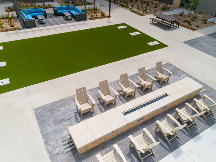 Spacious outdoor courtyard complete with yard games at Encore Boulevard One Apartments, 7108 E Lowry Boulevard, CO