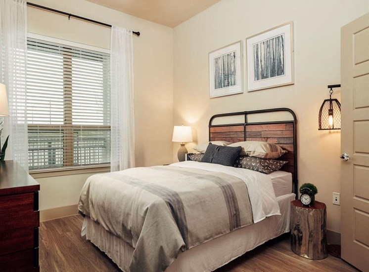 Spacious bedrooms with woodlike flooring