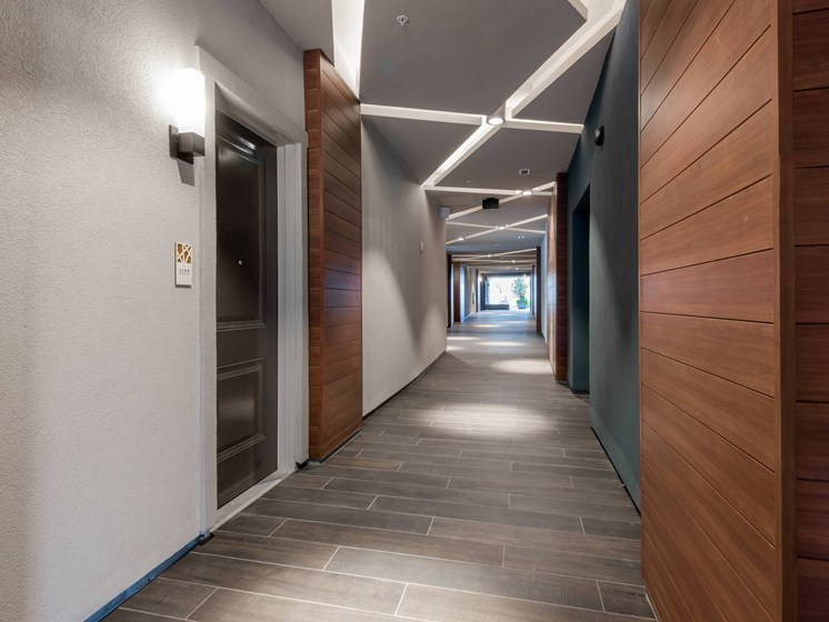 Modern and inviting corridors at Encore Boulevard One Apartments, 7108 E Lowry Boulevard, CO