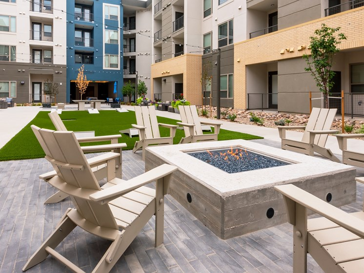 Ample fireside seating to share with friends  at Encore Boulevard One Apartments, 7108 E Lowry Boulevard, CO