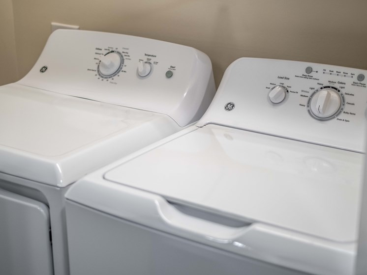 Stacked Washer/Dryer at Abberly CenterPointe Apartment Homes by HHHunt, Virginia