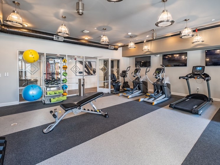 Fully Equipped Fitness Center at Abberly CenterPointe Apartment Homes by HHHunt, Midlothian, VA