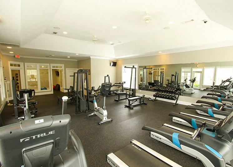 Fitness center with cardio and strength equipment at Abberly Green Apartment Homes by HHHunt, Mooresville
