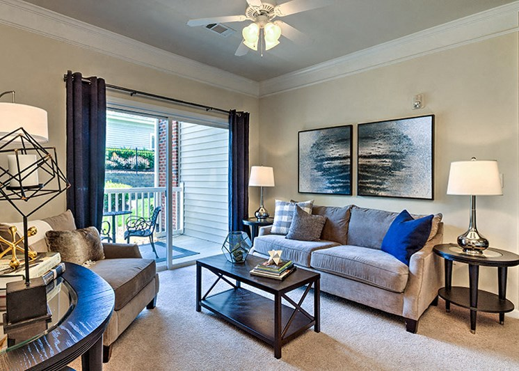 Open living room with wood-look flooring at Abberly Green Apartment Homes by HHHunt, North Carolina