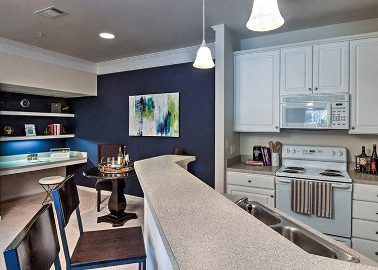 Wood-look flooring throughout dining & living space at Abberly Green Apartment Homes by HHHunt, Mooresville North Carolina
