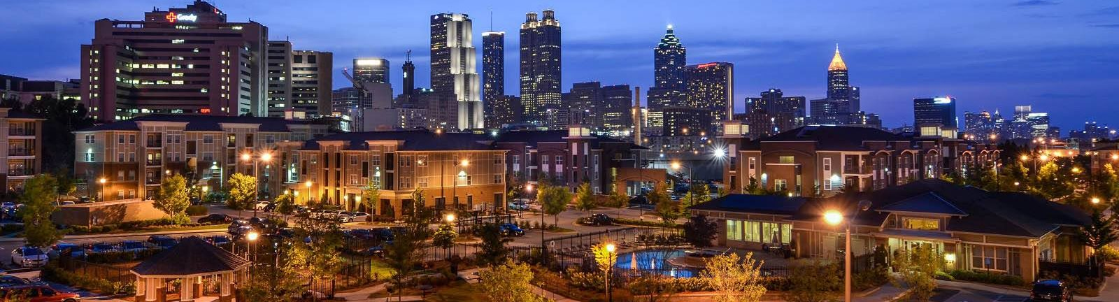 Atlanta city skyline with Ashley Auburn Pointe Apartments Swimming Pool