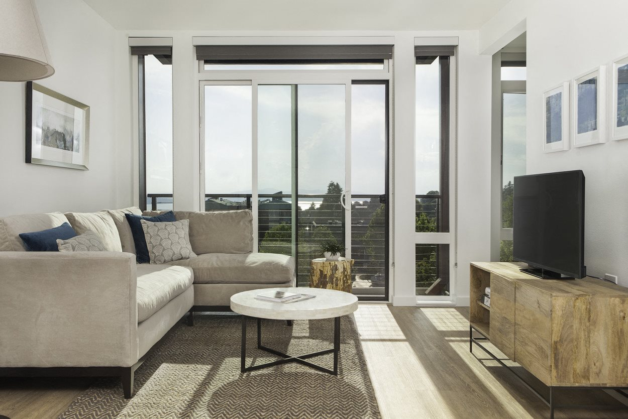 4730 California Apartments Model Living Room Floor-to-Ceiling Windows