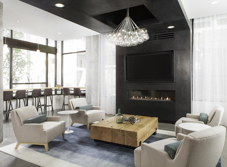 4730 California Apartments The Junction Room with Seating and Television