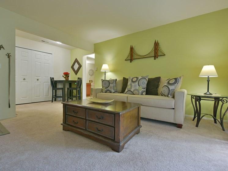 Carpeted Living Room at Sycamore Creek Apartments, Michigan, 48359