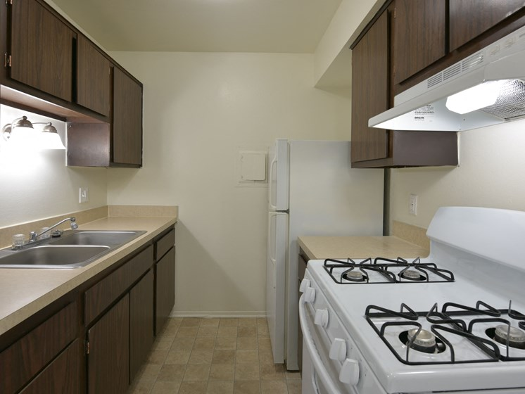 Kitchen with Espresso Cabinetry at Sycamore Creek Apartments, Orion, Michigan