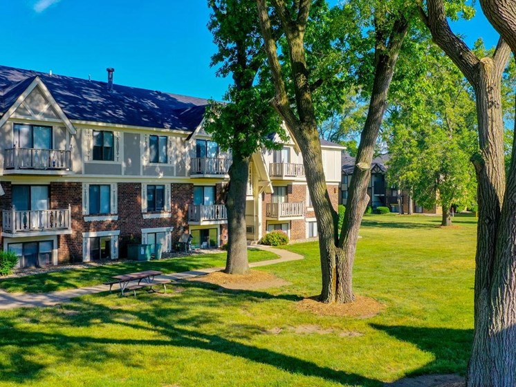 Green Spaces With Mature Trees at Fairlane Apartments, Springfield, MI
