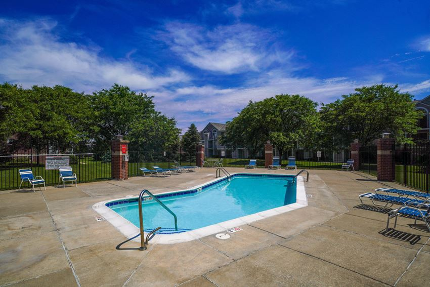 Refreshing pool and large sundeck with free Wi-Fi at Foxwood and The Hermitage, Portage, Michigan