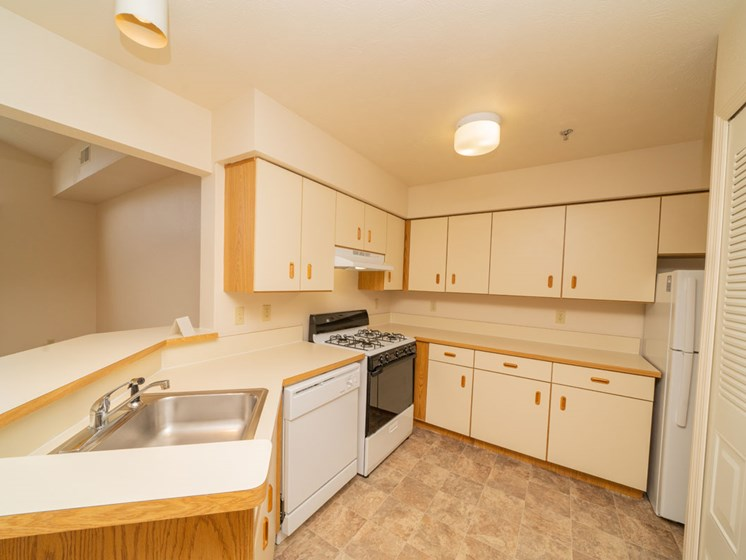 Kitchen with Breakfast Bar at Canal 2 Apartments in Lansing, Michigan