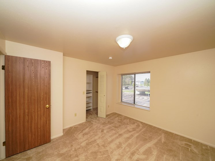 Walk-in Closet with Organizers at Canal Club Apartments in Lansing, MI