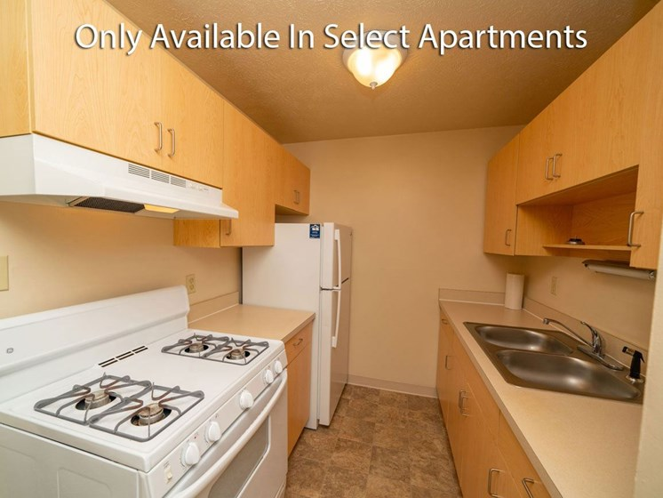 Galley Kitchen with Gas Range at Hickory Village Apartments, Mishawaka, 46545