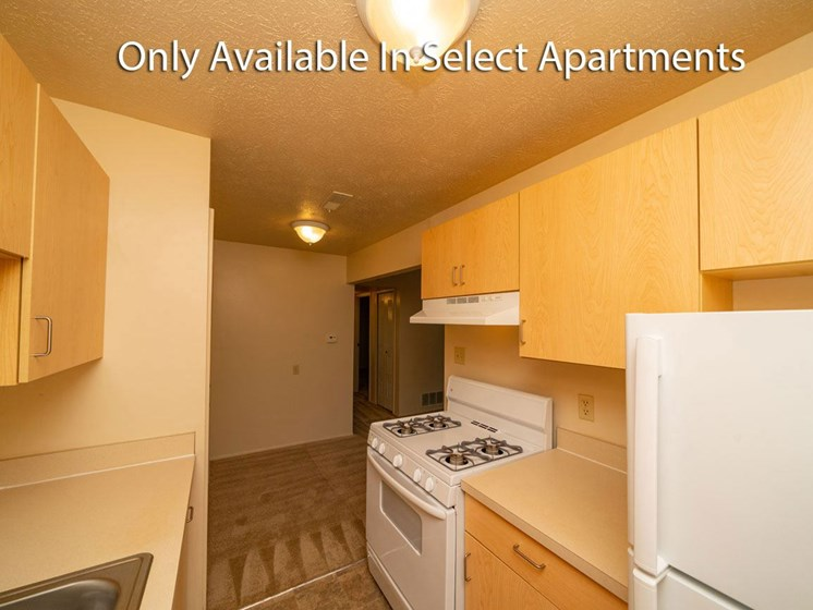 Kitchen with Gas Range at Hickory Village Apartments in Mishawaka, IN