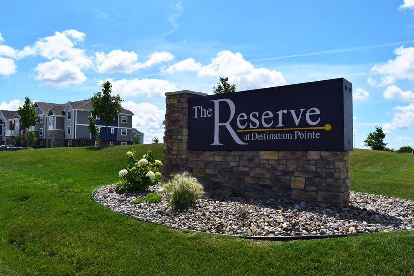 Entrance Sign for The Reserve at Destination Pointe in Grimies, IA
