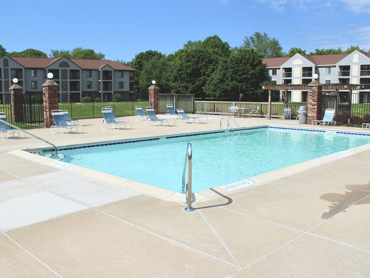 Pool With Lounge Chairs at Emerald Park Apartments in Kalamazoo, MI