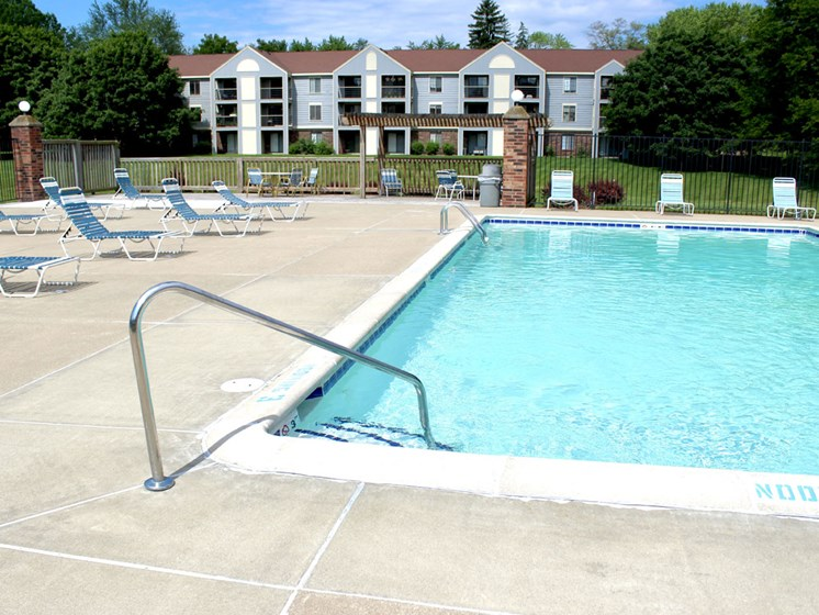 Pool With Large Sundeck at Emerald Park Apartments in Kalamazoo, MI