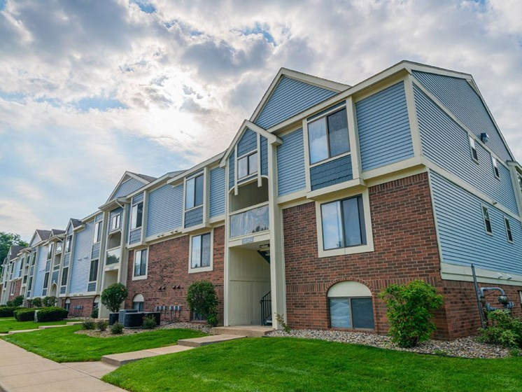 Apartment Building with Walking Path at Arbor Lakes Apartments, Elkhart, IN