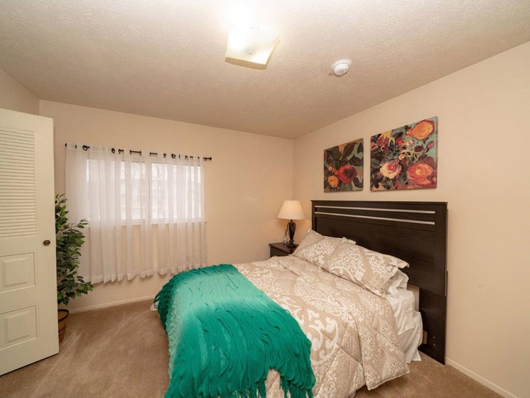 Bedroom With Expansive Windows at Arbor Lakes Apartments, Elkhart